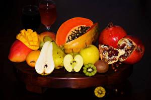Image Fruit Pomegranate Pears Kiwifruit Apples Pumpkin Black background Food