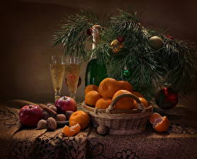 Images Holidays New year Still-life Mandarine Sparkling wine Nuts Apples Cinnamon Branches Balls Wicker basket Bottle Stemware Food
