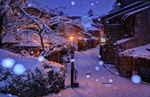 Picture Japan Kyoto Winter Houses Street Snow Night time Street lights Cities