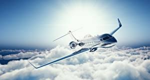 Bilder Flugzeuge Verkehrsflugzeug Flug Wolke Learjet 45 Luftfahrt