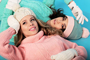 Wallpapers Two Winter hat Sweater Glance Glove young woman