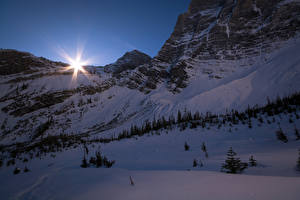 Wallpapers Canada Parks Winter Evening Banff Snow Rays of light Crag Nature