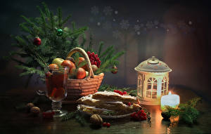 Wallpapers New year Still-life Candles Fruit Pastry Drink Nuts Lantern Branches Wicker basket Stemware Food