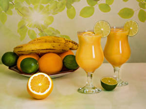 Fotos Saft Bananen Zitrone Apfelsine Weinglas Lebensmittel