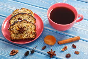 Bilder Keks Zimt Sternanis Tee Rosinen Schalenobst Bretter Teller Tasse das Essen