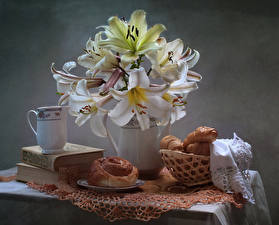 Photo Still-life Bouquet Lilies Pastry Buns Jug container Book flower Food
