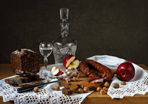 Picture Still-life Sausage Vodka Bread Nuts Apples Allium sativum Cutting board Shot glass Bottles Food