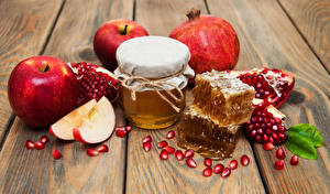 Image Honey Apples Pomegranate Wood planks Jar Grain Food