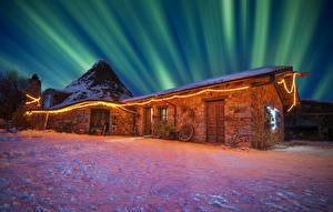 Pictures Italy Houses Winter Polar light Fairy lights Snow Night time Sardinia Cities