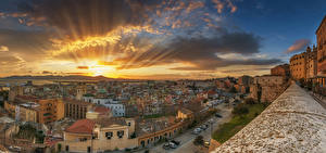 Bilder Italien Sonnenaufgänge und Sonnenuntergänge Haus Himmel Wolke Lichtstrahl Cagliari Städte