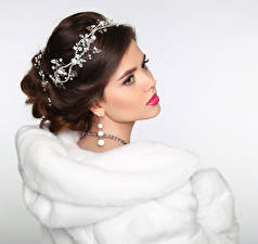 Pictures Jewelry White background Brown haired Fur coat Earrings young woman