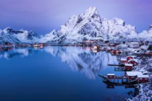 Bilder Norwegen Winter Gebirge See Haus Abend Schnee Reine Städte