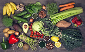 Pictures Still-life Vegetables Tomatoes Bell pepper Bananas Carrots Avocado Strawberry Nuts Potato Cucumbers Food