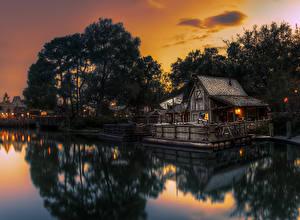 Fotos USA Disneyland Park Teich Gebäude Abend Kalifornien Anaheim Design Bäume Natur