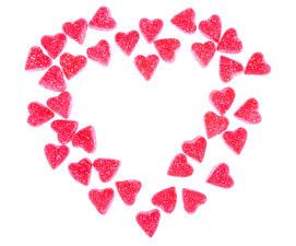 Bilder Valentinstag Süßware Marmelade Weißer hintergrund Herz Rosa Farbe Lebensmittel