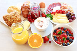 Pictures Cappuccino Juice Fruit preserves Muesli Berry Orange fruit Buns Croissant Breakfast Cup Pitcher Jar Sliced food Egg Food