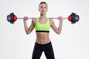 Fotos Fitness Grauer Hintergrund Bauch Hantelstange Mädchens Sport