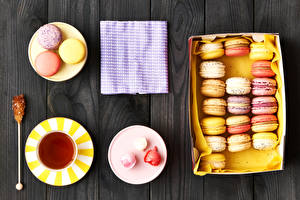 Image Tea Confectionery Wood planks Plate Cup French macarons Food