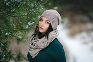 Pictures Winter Brunette girl Winter hat Scarf Glance Branches Girls