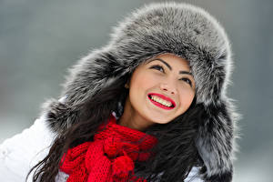 Pictures Winter Gray background Face Smile Winter hat Scarf Teeth Girls