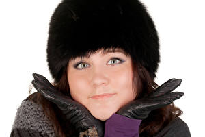 Photo Winter White background Winter hat Glance Glove Face young woman