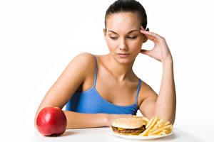 Bilder Äpfel Fast food Weißer hintergrund Braune Haare Frühstück junge Frauen