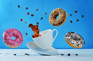 Bilder Donut Kaffee Farbigen hintergrund Tasse Getreide Lebensmittel