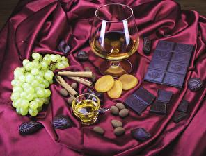 Bilder Alkoholische Getränke Schokolade Weintraube Zimt Weinglas