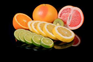 Bilder Zitrusfrüchte Zitrone Apfelsine Grapefruit Schwarzer Hintergrund