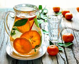 Pictures Drinks Mandarine Lemonade Wood planks Pitcher Highball glass Food