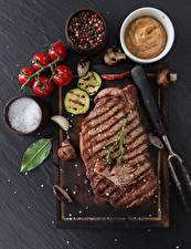 Image Meat products Tomatoes Seasoning Cutting board Salt Food