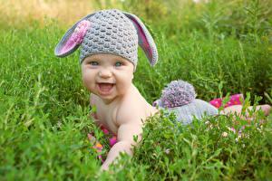 Photo Rabbits Newborn Winter hat Smile Grass Children