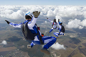 Photo Sky Parachuting skydiving Clouds Uniform Sport