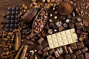 Bakgrunnsbilder Søt mat Sjokolade Nøtter Godteri Sjokoladeplate Kakaopulver