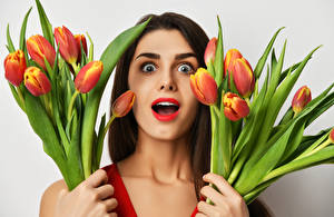 Images Tulips Brown haired Surprise emotion Face Girls