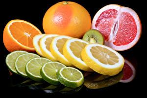 Bilder Zitrusfrüchte Zitrone Orange Frucht Grapefruit Schwarzer Hintergrund Geschnitten