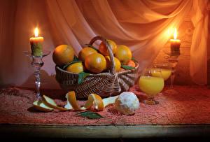 Pictures Mandarine Juice Candles Wicker basket Stemware