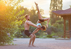 Pictures Man Gymnastics 2 Physical exercise Legs young woman Sport