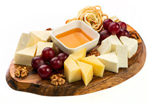 Images Cheese Grapes Nuts White background Cutting board