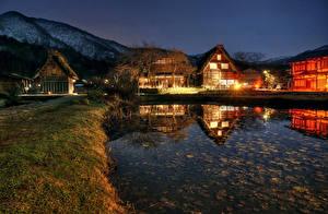 Фотографии Япония Здания Пруд Деревня В ночи Shirakawa-mura Города
