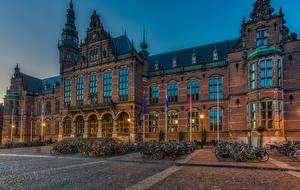 Pictures Netherlands Building Evening Street Bike Street lights Groningen Cities