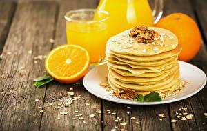 Fotos Eierkuchen Schalenobst Apfelsine Bretter Teller Lebensmittel