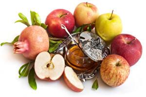 Fotos Äpfel Granatapfel Honig Weißer hintergrund