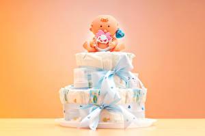 Hintergrundbilder Torte Farbigen hintergrund Geschenke Design Puppe Schleife Säugling Herz