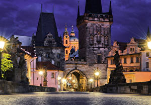 Pictures Czech Republic Prague Houses Bridges Roads Sculptures Charles Bridge Night time Street lights Cities