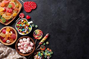 Fotos Süßware Bonbon Marmelade Dauerlutscher Grauer Hintergrund Herz Lebensmittel