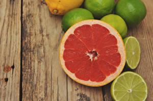 Photo Citrus Lemons Grapefruit Wood planks Food