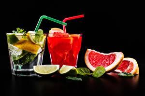 Bilder Grapefruit Schwarzer Hintergrund Trinkglas Lebensmittel
