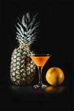 Pictures Juice Pineapples Orange fruit Black background Stemware