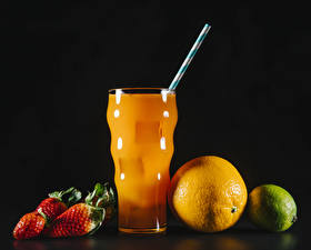 Pictures Juice Strawberry Orange fruit Lime Black background Highball glass Food